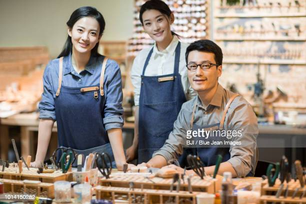 portrait of confident leather craftspeople in studio - leather shirt stock pictures, royalty-free photos & images