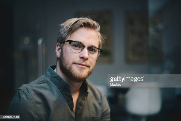 portrait of confident male computer programmer in office - blonde hair stock pictures, royalty-free photos & images