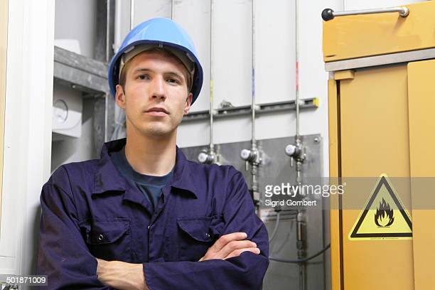 Portrait of confident male electrician in factory