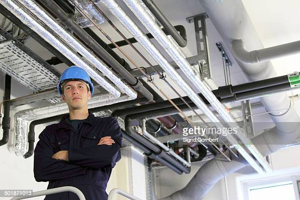 portrait of confident male engineer in factory - sigrid gombert stock pictures, royalty-free photos & images