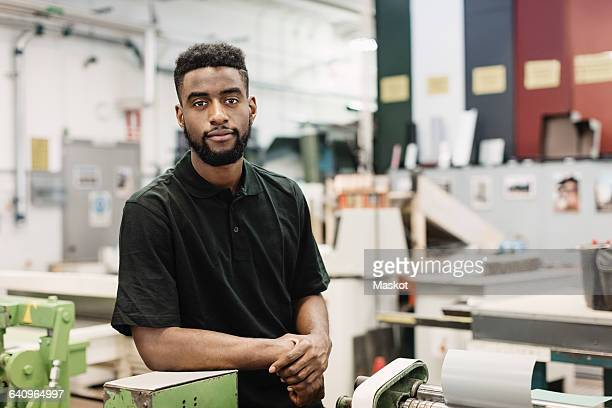 Portrait of confident male student in workshop