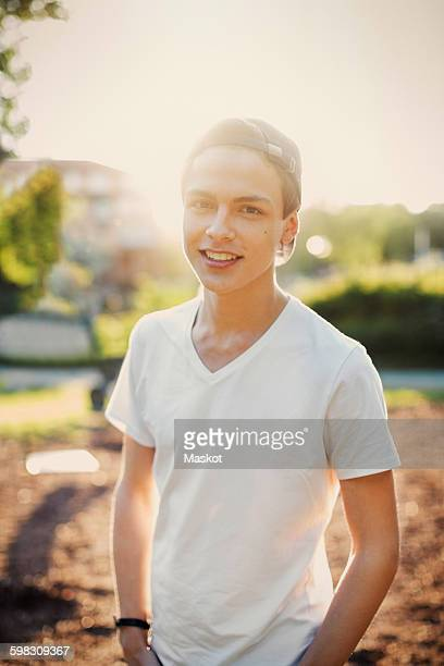 Portrait of confident male teenager standing outdoors