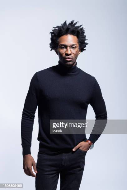portrait of confident man in black turtleneck - one man only stock pictures, royalty-free photos & images
