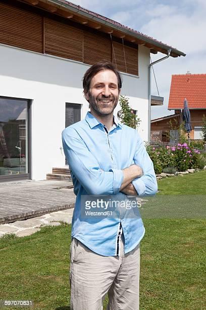 Portrait of confident man standing in garden