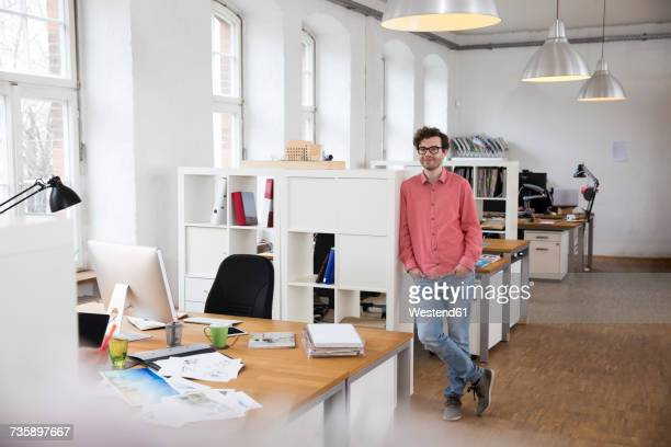 Portrait of confident man standing in office