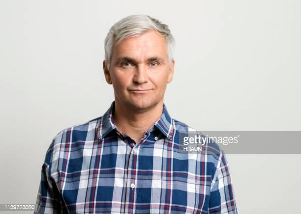 portrait of confident man wearing plaid shirt - plaid shirt stock pictures, royalty-free photos & images