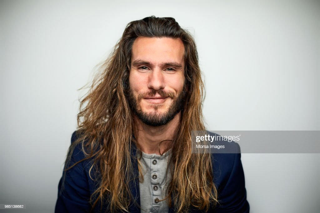 Portrait of confident man with long hair : Stock-Foto