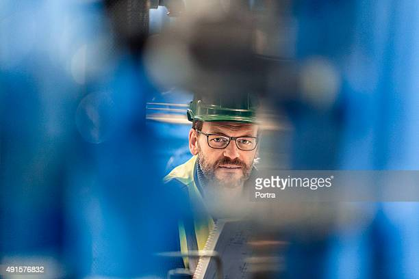 Portrait of confident manufacturing expert at factory