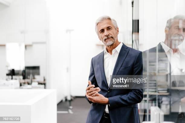 Portrait of confident mature businessman in office