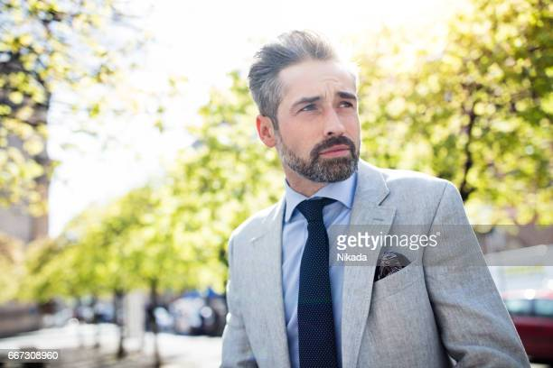portrait of confident mature businessman outdoors - grey blazer stock pictures, royalty-free photos & images