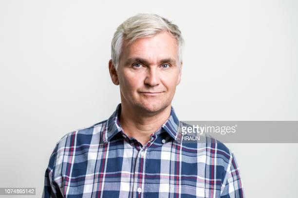 portrait of confident mature businessman - plaid shirt stock pictures, royalty-free photos & images