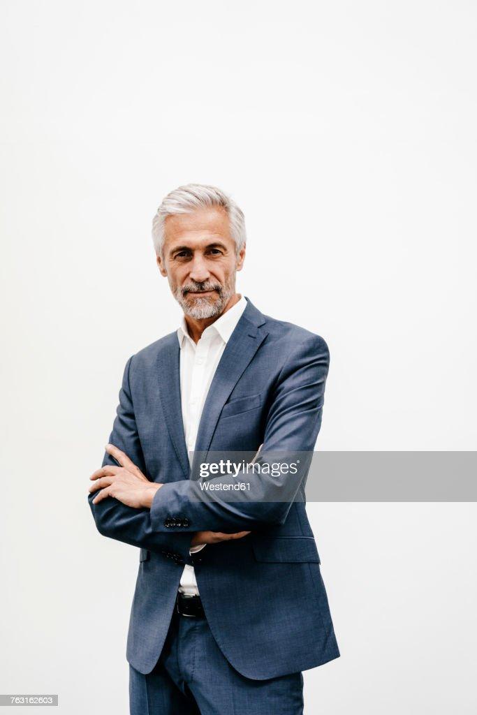 Portrait of confident mature businessman : Stock Photo