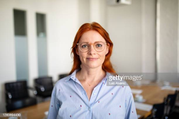 portrait of confident mature businesswoman - redhead stock pictures, royalty-free photos & images
