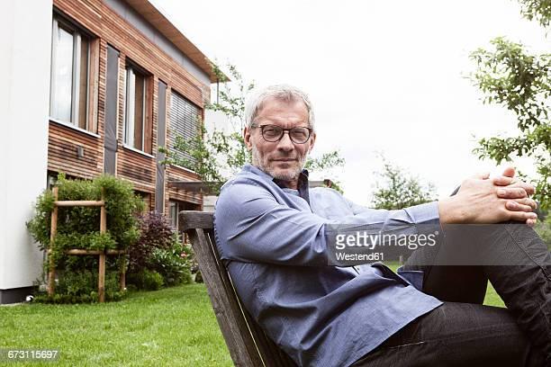 Portrait of confident mature man in garden