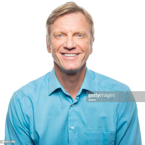 portrait of confident mature man smiling - handsome 50 year old men stock photos and pictures