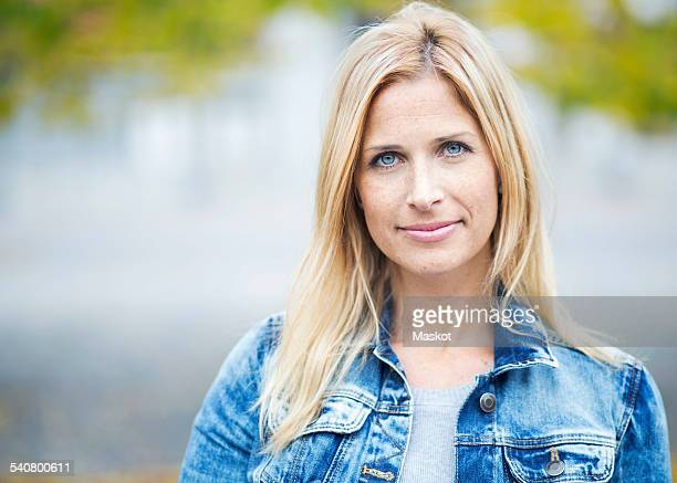 Portrait of confident mid adult woman against lake