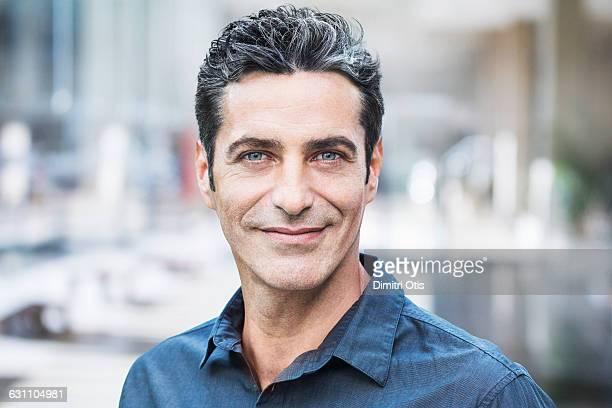 Portrait of confident middle aged man smiling