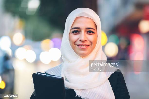 portrait of confident muslim businesswoman - veil stock photos and pictures