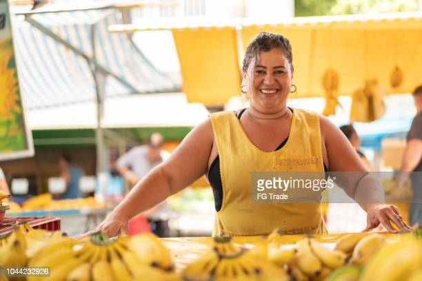 Portrait of confident owner - Selling bananas at farmers market