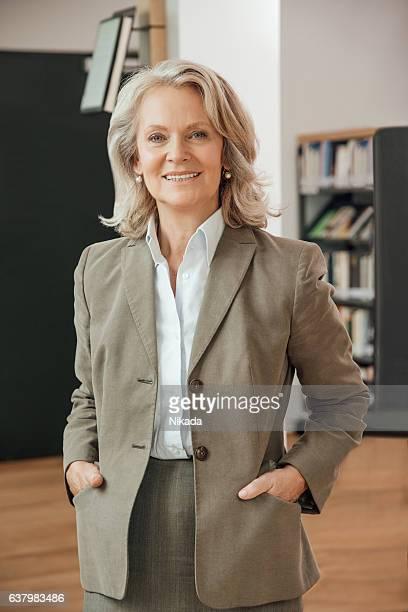 Portrait of confident professor in university