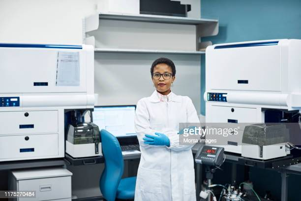 portrait of confident scientist at laboratory - biologist stock pictures, royalty-free photos & images