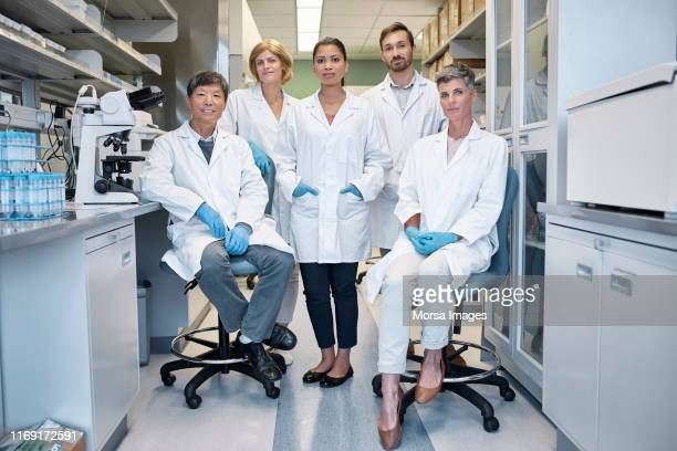 portrait of confident scientists in laboratory - healthcare stock pictures, royalty-free photos & images