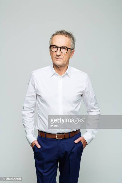 portrait of confident senior businessman - white shirt stock pictures, royalty-free photos & images