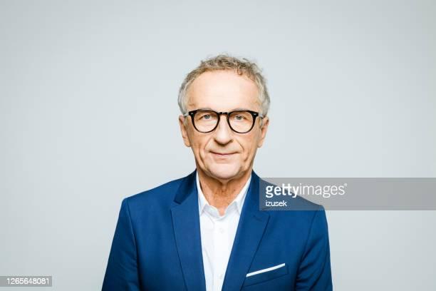portrait of confident senior businessman - working seniors stock pictures, royalty-free photos & images