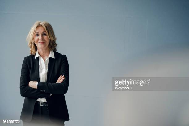 portrait of confident senior businesswoman - businesswoman stock pictures, royalty-free photos & images