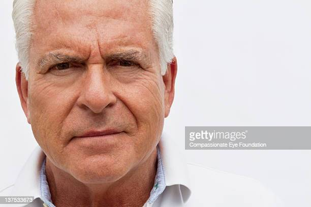 "portrait of confident senior man, close up - ""compassionate eye"" stock pictures, royalty-free photos & images"