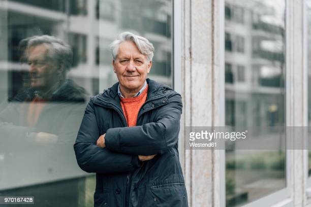 portrait of confident senior man in the city - one senior man only stock pictures, royalty-free photos & images