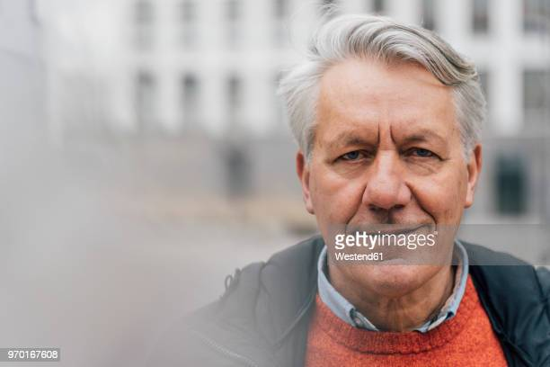 Portrait of confident senior man outdoors