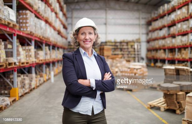 portrait of confident senior warehouse manager - argentina women stock pictures, royalty-free photos & images