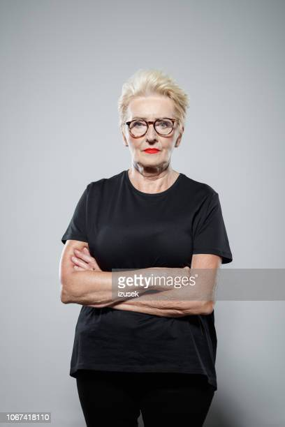 portrait of confident senior woman - warrior person stock pictures, royalty-free photos & images