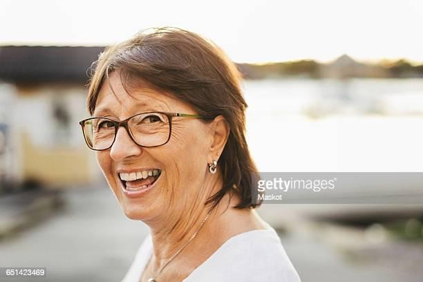 Portrait of confident senior woman smiling outdoors