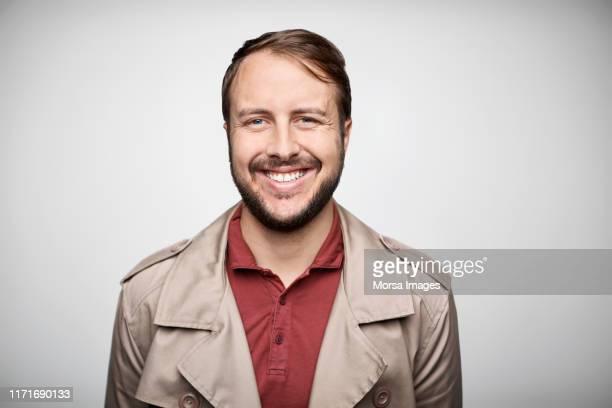 portrait of confident smiling mid adult owner - schnurrbart stock-fotos und bilder