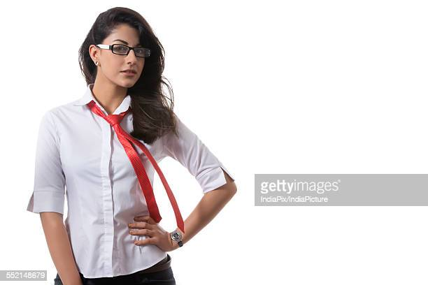 Portrait of confident stylish businesswoman wearing glasses over white background