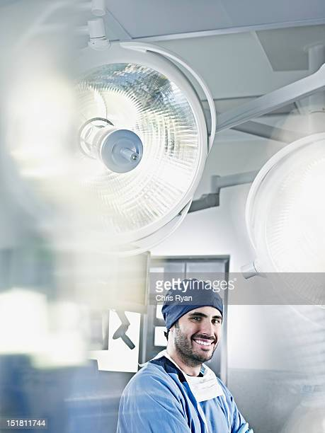 Portrait of confident surgeon under surgical lights