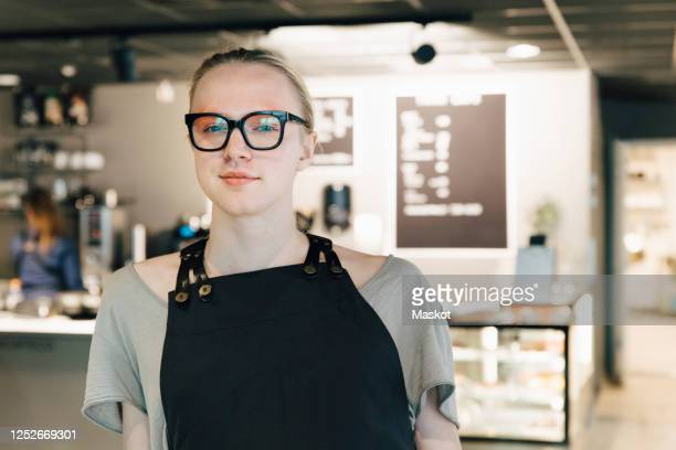 portrait of confident transgender owner standing in coffee shop - gender fluid stock pictures, royalty-free photos & images