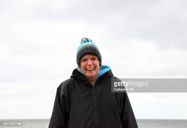 portrait of confident woman after open water swimming - menopossibilities stock pictures, royalty-free photos & images