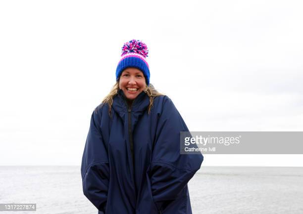 portrait of confident woman after open water swimming - showus stock pictures, royalty-free photos & images