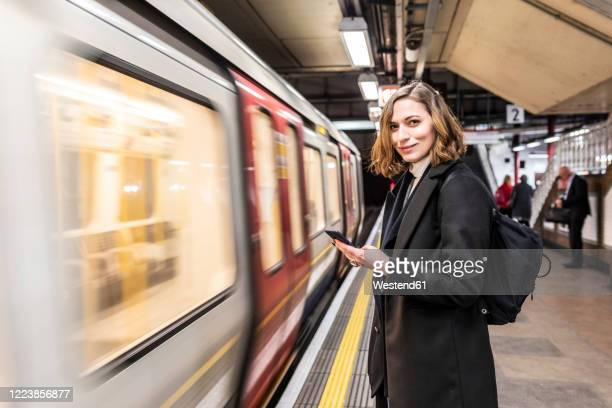 portrait of confident woman at the subway station, london, uk - waiting stock pictures, royalty-free photos & images
