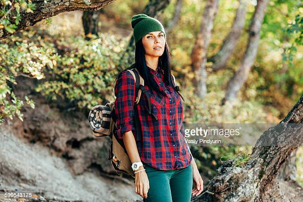 Portrait of confident woman hiking in forest