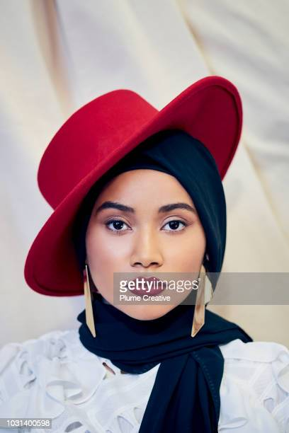 Portrait of Confident woman in Red Fedora