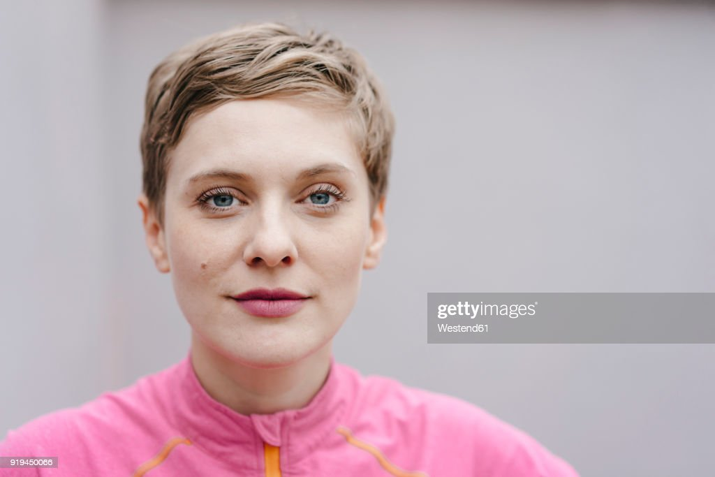 Portrait of confident woman in sportswear : Stock Photo