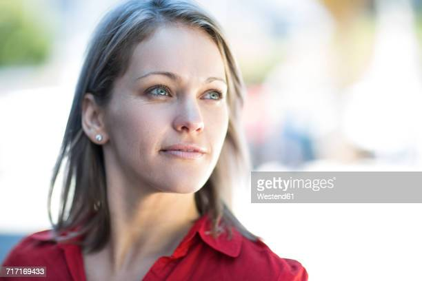 Portrait of confident woman looking sideways outdoors