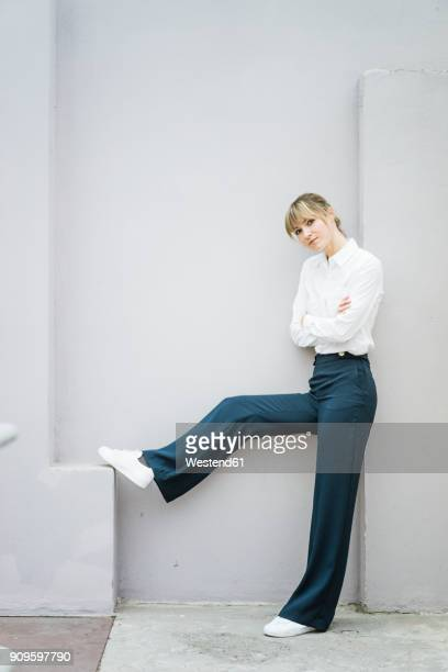 portrait of confident woman standing - white pants stock pictures, royalty-free photos & images