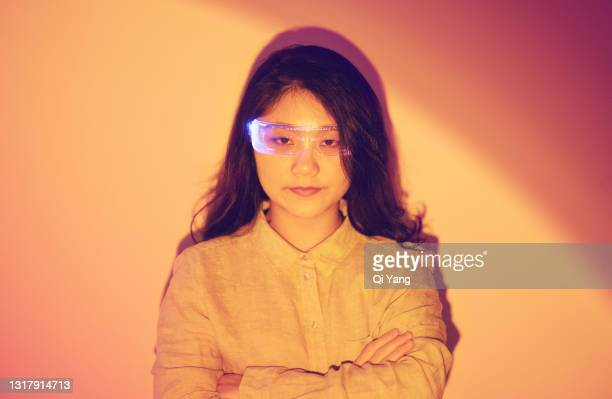 portrait of confident woman wearing augmented reality glasses - graphical user interface stock pictures, royalty-free photos & images