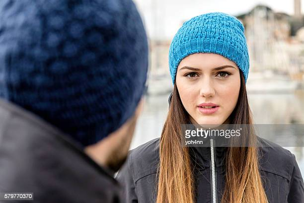 Portrait of confident woman wearing knit hat
