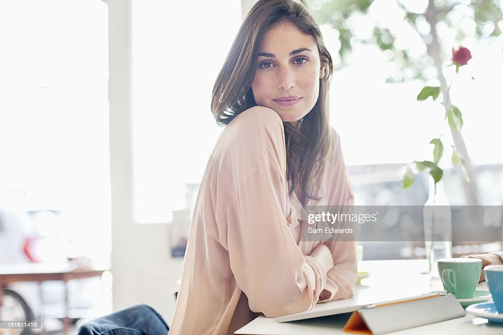 Portrait of confident woman with digital tablet in cafe : Stock Photo